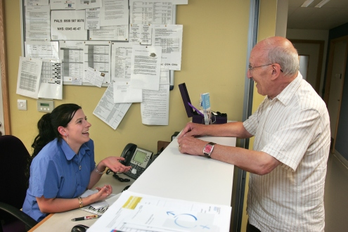 Receptionist talking to a patient